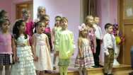 Stock Video Footage of Camera review of 4-5 years old kids reciting poetry from the stage