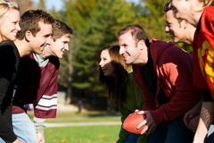football: teams of friends playing football - stock photo