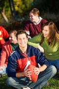 Stock Photo of football: relaxing with friends in park