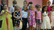 Stock Video Footage of Young girls and boys reciting poetry from the stage in kindergarten