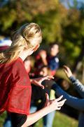 football: woman ready to catch football - stock photo