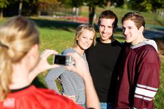football: friends have picture taken - stock photo