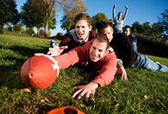Football: tackled guy tries for touchdown Stock Photos