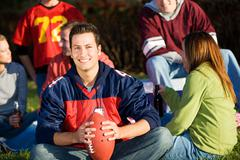 football: football guy with friends at picnic - stock photo