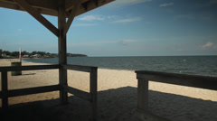 View of beach from within gazebo (1 of 4) Stock Footage