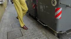 Spain Catalonia Barcelona man throw away garbage rubbish Stock Footage