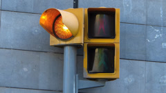 Spain Catalonia Barcelona traffic light green turn red Stock Footage