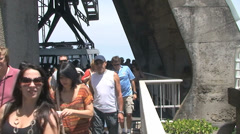 027 Rio, tourists leaving cable car, Christ the Redeemer, Sugarloaf Mountain. Stock Footage