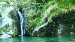 Waterfall and brook in the alps. Stock Footage
