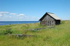 old wooden shed at the lake bank - stock photo