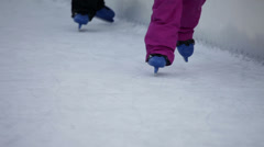 Detail shot of blue kiddie skates staggering on ice rink Stock Footage