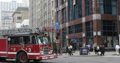 Ultra HD 4K UHD Firefighters Chicago Fire Truck Engine Passing Magnificent Mile Stock Footage