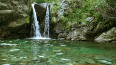 Romantic waterfall in the mountains. Stock Footage