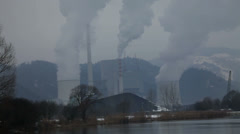 Four chimneys polluting the air with smog - stock footage