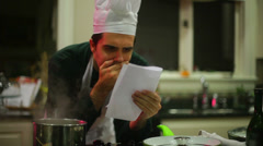 Chef reading bad review read Stock Footage