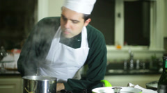 Chef smelling really bad food Stock Footage