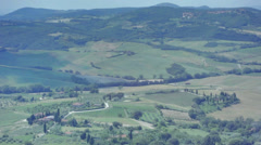 Shadow of a Cloud Passes Over Tuscany Landscape Italy - 29,97FPS NTSC Stock Footage