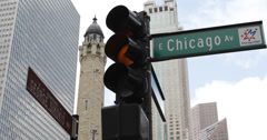 Ultra HD 4K Chicago Avenue Sign Water Tower High Rise Office Building Red Lights Stock Footage