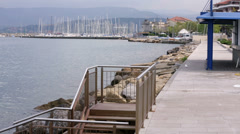 Perspective shot of stairs and docks with harbour at the back Stock Footage
