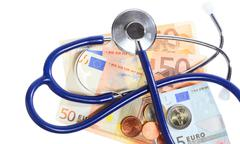 cost of health care: stethoscope on euro money - stock photo