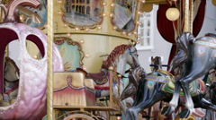 Wooden horses and fairytale carriges on running roundabout Stock Footage