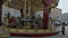 Old and spinning merry-go-round with couple of kids Stock Footage