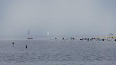 Long panoramic pan shot of horizont full of sailboats and ships. Stock Footage