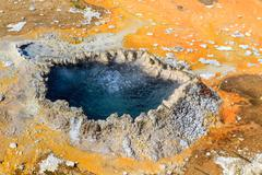 yellowstone national park, chinese spring in the upper geyser basin, wyoming - stock photo