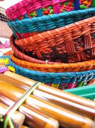 andean flutes and baskets. - stock photo