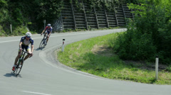 Close shot of two leading cyclist way ahead of the pack on warm sunny day Stock Footage