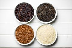 various rice in ceramic bowls - stock photo