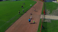 Aerial shot of children bibycle race competition from remote helicopter Stock Footage