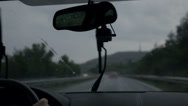 Stock Video Footage of Windscreen wipers are removing rain while driving on motorway at evening