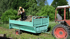 strong man unload tree logs for firewood from tractor trailer - stock footage