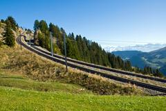 Railroad tracks in the mountains - stock photo