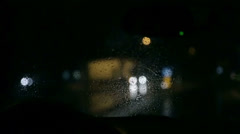 Shot through windshield of nightdrive on rainy night Stock Footage