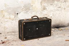 Old vintage suitcase - stock photo