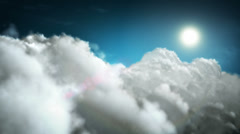 Flying through white soft clouds with sun and lens flare. Loopable. Stock Footage