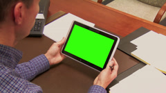 Office Manager Uses Green Screen Tablet PC at Desk Stock Footage