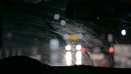 Stock Video Footage of Car wipers are wiping windscreen in a city nightdrive