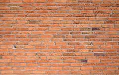 Orange brickwall - stock photo