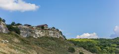 house on top of chufut-kale, the cave city near bakhchisaray - stock photo
