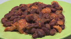 Garnish delicious red beans fresh herbs piece meat menu plate cuisine course  Stock Footage