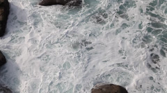 Birds eye view of waves at Lands End, Cornwall Stock Footage