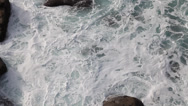 Stock Video Footage of Birds eye view of waves at Lands End, Cornwall