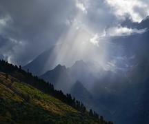 sunbeam in mountains - stock photo