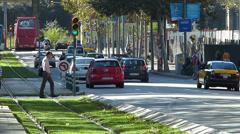 Stock Video Footage of Spain Catalonia Barcelona Av Diagonal Traffic pedestrian cross-walk tram