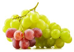 Bunch of fresh grapes isolated on white Stock Photos