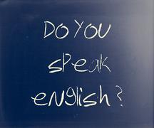 """do you speak english"" handwritten with white chalk on a blackboard Stock Photos"