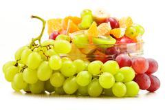 Fruit salad bowl isolated on white Stock Photos